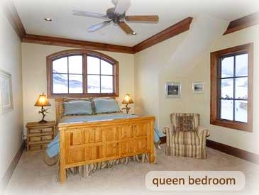 queen bed at the bineasz house in crested butte